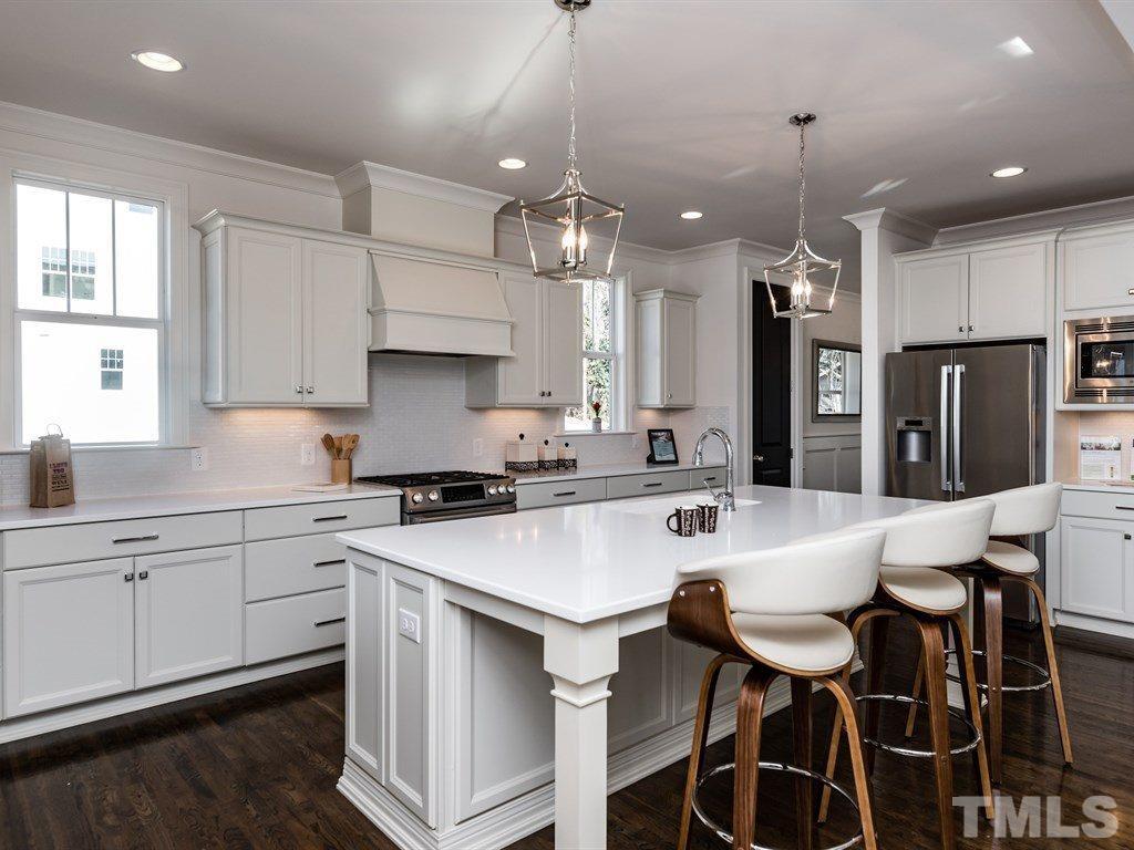 All white staged kitchen.