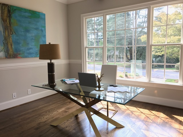 Staged office with large windows